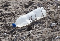 Plastic bottle in the sand on nature. trash Stock Photo