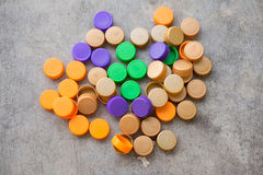 Plastic bottle screw caps. Use for inspiring recycled or up-cycled arts and crafts projects Royalty Free Stock Photos
