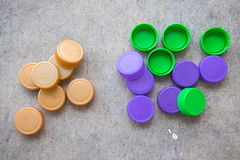 Plastic bottle screw caps. Use for inspiring recycled or up-cycled arts and crafts projects Stock Photography