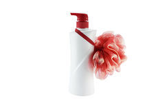 Plastic bottle and sponge scrub skin on a white background Royalty Free Stock Photography
