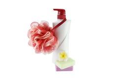 Plastic bottle and sponge scrub skin on a white background Stock Image