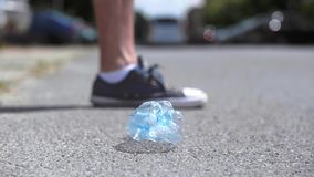 Plastic bottle in the street. Close up of plastic bottle in the street stock video