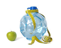 Plastic bottle of water and apple Royalty Free Stock Photo
