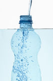 Plastic bottle in water with bubbles inside Royalty Free Stock Photography