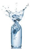 Plastic bottle with water splash isolated stock image