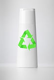 Plastic bottle on white with recycle symbol. Royalty Free Stock Photo