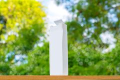 Plastic bottle white on the wood and tree blurry bokeh background in garden. Using wallpaper for package work photo Stock Photo