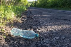 Free Plastic Bottle With Water By The Road Stock Photo - 153314010