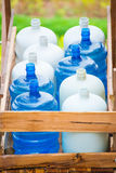 Plastic bottled water on wooden cart Stock Photos