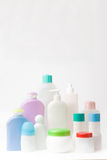 Plastic bottles. Group of different plastic containers on white background Stock Images