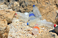 Plastic bottles on the beach Royalty Free Stock Images
