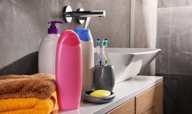 Plastic bottles of body care and beauty products in the bathroom Stock Photo