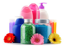Plastic bottles of body care and beauty products over white Stock Images