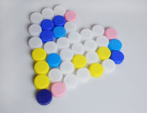 Plastic bottles caps heart Royalty Free Stock Photography