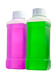 Plastic bottles with cleaning liquid. Two transparent plastic bottles with color cleaning liquid. Standing one by one Stock Images
