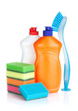 Plastic bottles of cleaning products, sponges and brush Royalty Free Stock Photography