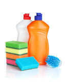 Plastic bottles of cleaning products, sponges and brush Royalty Free Stock Images