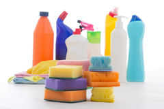 Plastic bottles of cleaning products and sponges  on white Royalty Free Stock Image