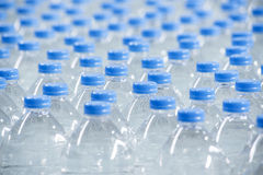 Plastic bottles on conveyor belt Royalty Free Stock Image