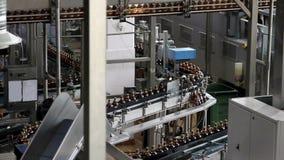 Plastic bottles on conveyor or water bottling machine stock video
