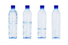 Plastic bottles with different water levels inside Royalty Free Stock Photos