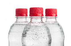 Plastic bottles of drinking water isolated Stock Images