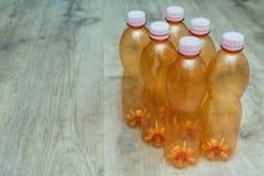 Plastic bottles. Ecological separation of household waste. Empty plastic bottles in daylight on wooden floor royalty free stock image