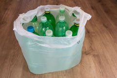 Plastic bottles. Ecological separation of household waste. Empty pet bottles in a plastic bag royalty free stock photo