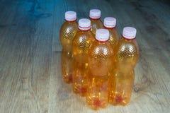 Plastic bottles. Ecological separation of household waste. Empty plastic bottles on wood floating floor stock images