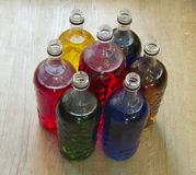 Bottles filled with liquid of different colors stock photos