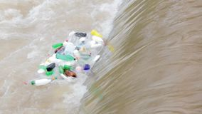 Plastic bottles float in a waterfall. Plastic bottles and trash float in a waterfall, environment pollution stock video