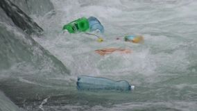 Plastic bottles floating and polluting at river stock video