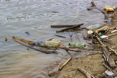Plastic bottles and garbage waste on the shore 4 Royalty Free Stock Photo