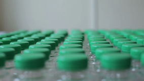 Plastic bottles with green lids closeup