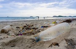 Free Plastic Bottles Left On The Dirty Sand Beach Stock Photo - 123391720
