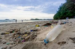 Free Plastic Bottles Left On The Dirty Sand Beach With Various Garbages Royalty Free Stock Photo - 123229275