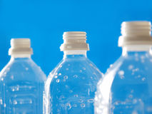 Plastic bottles in line. Pet bottles on blue back for ecological image Royalty Free Stock Photography