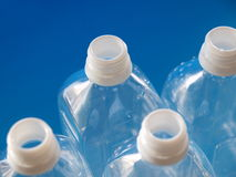 Plastic bottles in line. Pet bottles on blue back for ecological image Royalty Free Stock Image