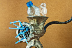 Plastic bottles in a mincer. Stylized idea of recycling plastic bottles with grinder Royalty Free Stock Image
