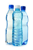 Plastic bottles of mineral water isolated on white Royalty Free Stock Photos