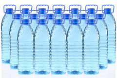 Plastic bottles of mineral water in a three row Royalty Free Stock Photography