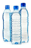 Plastic bottles of mineral water on white Stock Photo