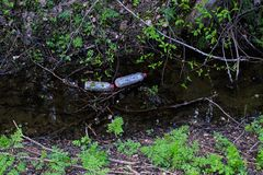 Plastic bottles pollute. The creek Stock Images