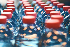 Plastic bottles with red caps stock photos