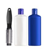 Plastic bottles shampoo and comb isolated on white Stock Image