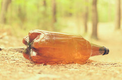 Plastic bottles spoil and pollute the ecological state of nature. Royalty Free Stock Photography
