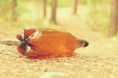 Plastic bottles spoil and pollute the ecological state of nature. Royalty Free Stock Image