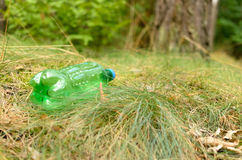 Plastic bottles spoil and pollute the ecological state of nature. Royalty Free Stock Photos