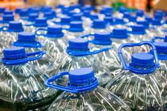 Plastic bottles with water 5 liters. On the market Stock Photography