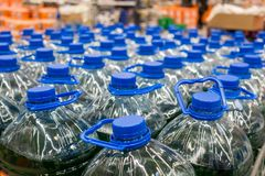Plastic bottles with water 5 liters. On the market Royalty Free Stock Photo